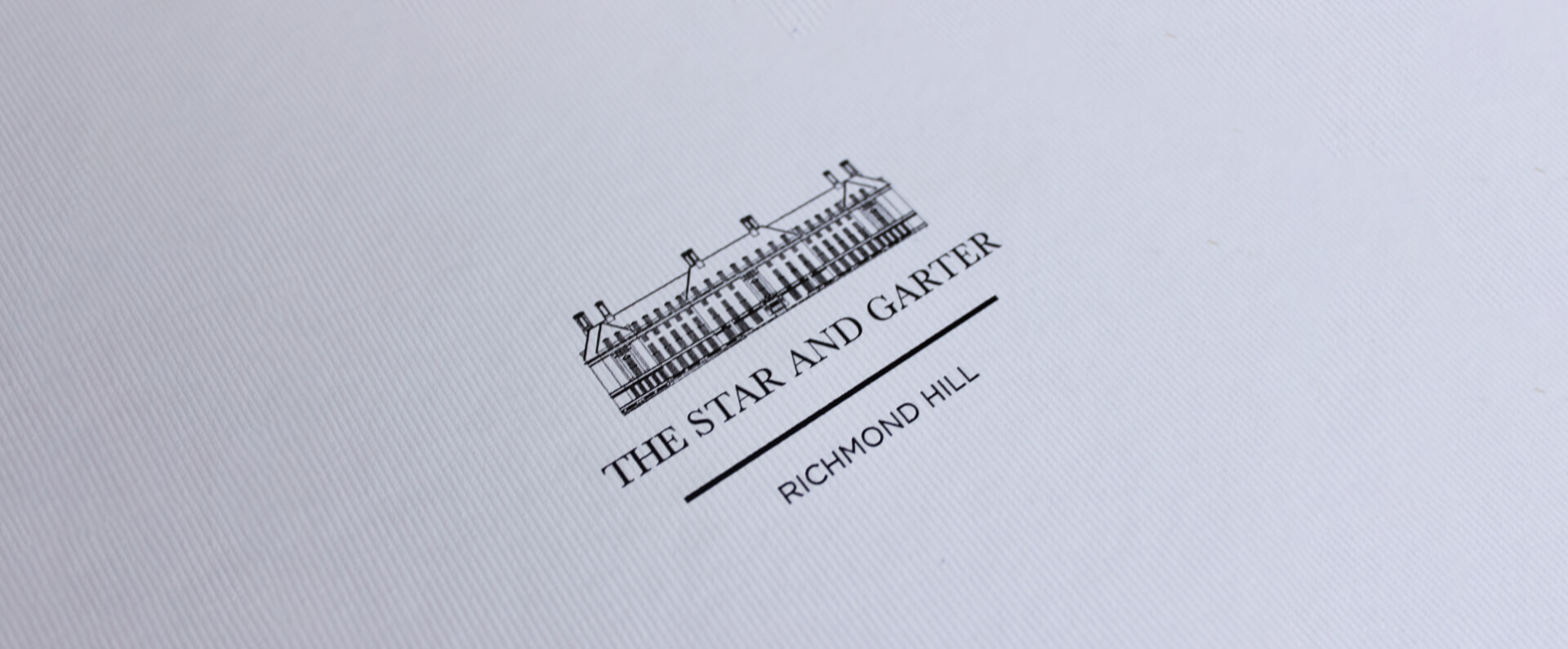 Star and Garter logo in print